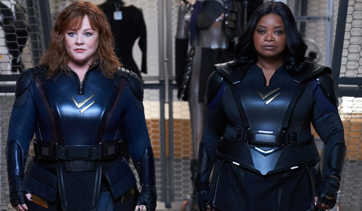 Melissa McCarthy and Octavia Spencer walk forward in uniform in Thunder Force.