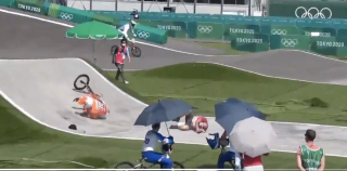 Niek Kimmann crashes on BMX track after colliding with an official crossing the field of play