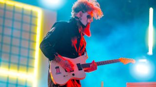 Jim Root of Slipknot performs live