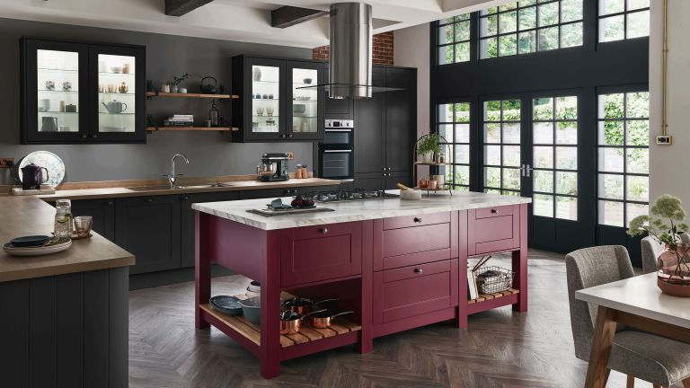 Dark grey kitchen with red kitchen island