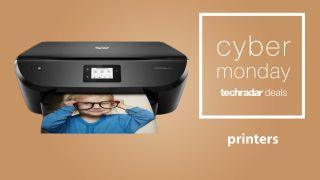 An HP Envy printer next to a TechRadar Cyber Monday printer deals logo against a light brown background