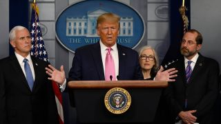 President Trump talks at a news briefing alongside HHS Secretary Alex Azar (right) and the CDC's Principal Deputy Director Dr. Anne Schuchat (2-R).