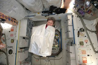 NASA astronaut Peggy Whitson pops out of a cargo bag during a prank on the International Space Station on Feb. 13, 2017.
