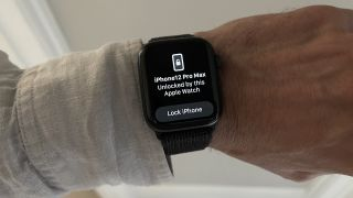 An Apple Watch showing that it has unlocked an iPhone with a Lock option