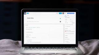 laptop open on WordPress CMS