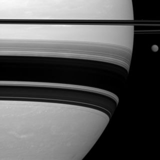 Cassini photo of Saturn, its rings and the moon Titan