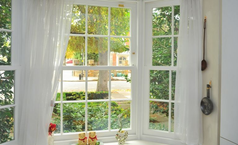 best window cleaning product: large window looking out onto street