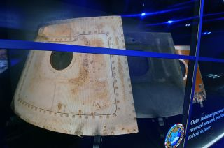 "The hatches from NASA's Apollo 1 command module are revealed in ""Ad Astra Per Aspera,"" a new exhibit at Kennedy Space Center Visitor Complex in Florida dedicated to the memory of the Apollo 1 crew, Gus Grissom, Ed White and Roger Chaffee."