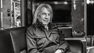 A photograph of Rick Parfitt sat in a cafe