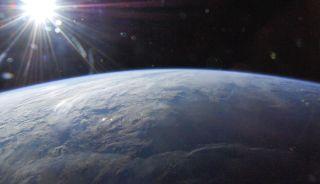 Sun in starburst over Earth