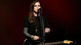 a shot of Laura Jane grace on stage