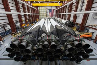 The SpaceX Falcon Heavy rocket that will launch the Saudi Arabian satellite Arabsat 6A is seen in its hangar near NASA's Kennedy Space Center Launch Complex 39A in Cape Canaveral, Florida. Liftoff is set for April 10, 2019.