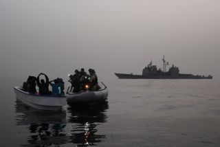 A visit, board, search and seizure team assigned to the guided-missile cruiser USS Anzio (CG 68) investigates a suspected pirate skiff in the Red Sea, Gulf of Aden, Somali Basin and Arabian Sea. Many pirate attacks are reported in the Gulf of Aden.