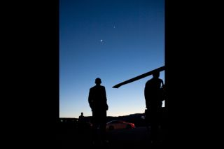 President Obama eyes Venus and the crescent moon in Colorado on April 24, 2012.