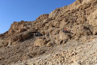 "Archaeologists recently discovered a cave (entrance, shown at left) near Qumran in Israel, though most of the ""Dead Sea Scrolls"" in the cave had been taken in the mid-20th century."
