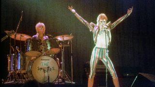 """Musician David Bowie performs onstage during his """"Ziggy Stardust"""" era in 1973 in Los Angeles, California"""
