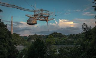 The Arecibo Observatory's radio telescope was built in a natural sinkhole in Puerto Rico, construction was completed in 1963.