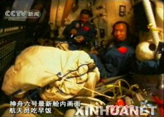 Shenzhou 6 Astronauts Adjust Spacecraft's Orbit