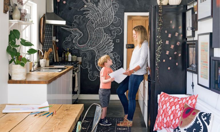 Theresa Gromski and Arlo in the newly-transformed kitchen