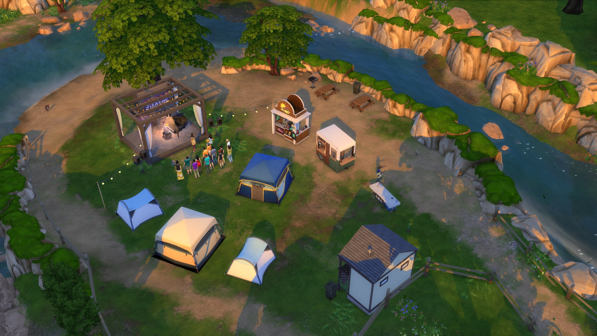 The Sims 4: a large blue tent placed in the middle the Sims Sessions festival site.