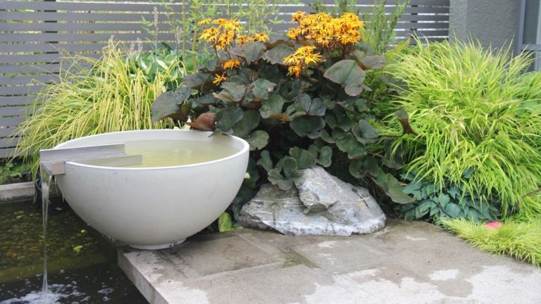 water feature ideas showing a modern bowl style water feature