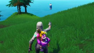 Fortnite Land a Bottle Flip on a target near a giant fish, llama, or pig