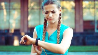 Unhappy woman with fitness tracker