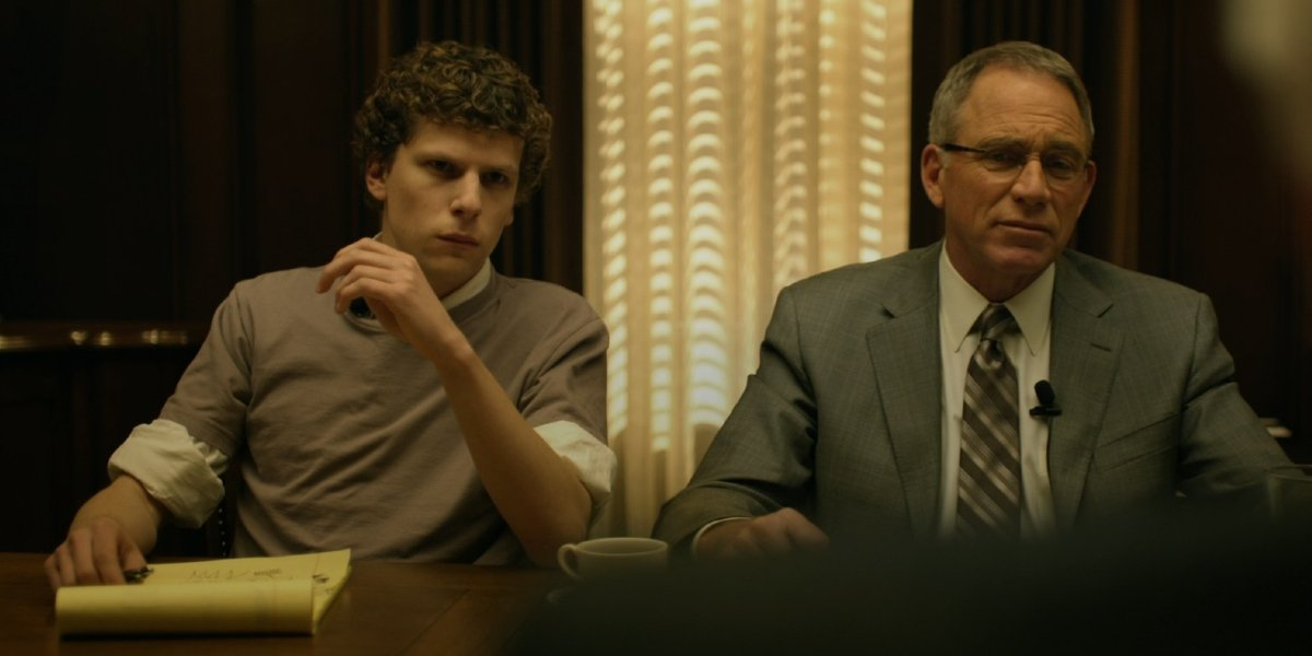 Jesse Eisenberg and John Getz in The Social Network