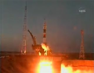 Astronaut Trio Rockets Toward Space Station