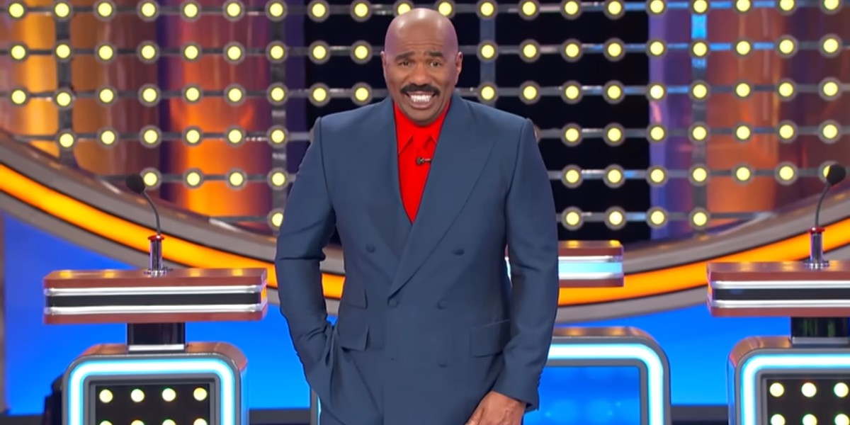 Steve Harvey laughing at a category on Family Feud