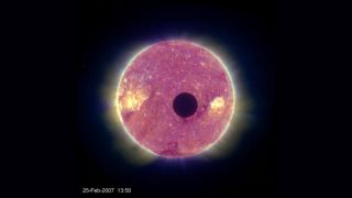 A 2007 image from the APL-built STEREO B spacecraft of the moon crossing in front of the sun. A new conceptual study proposes to observe the Earth in a similar way, to learn if the transit method can determine a planet's habitability.