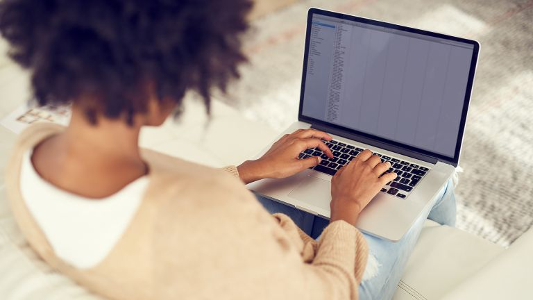 woman using laptop on her lap