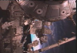 Shuttle Spacewalkers Make Vital ISS Railcar Repair