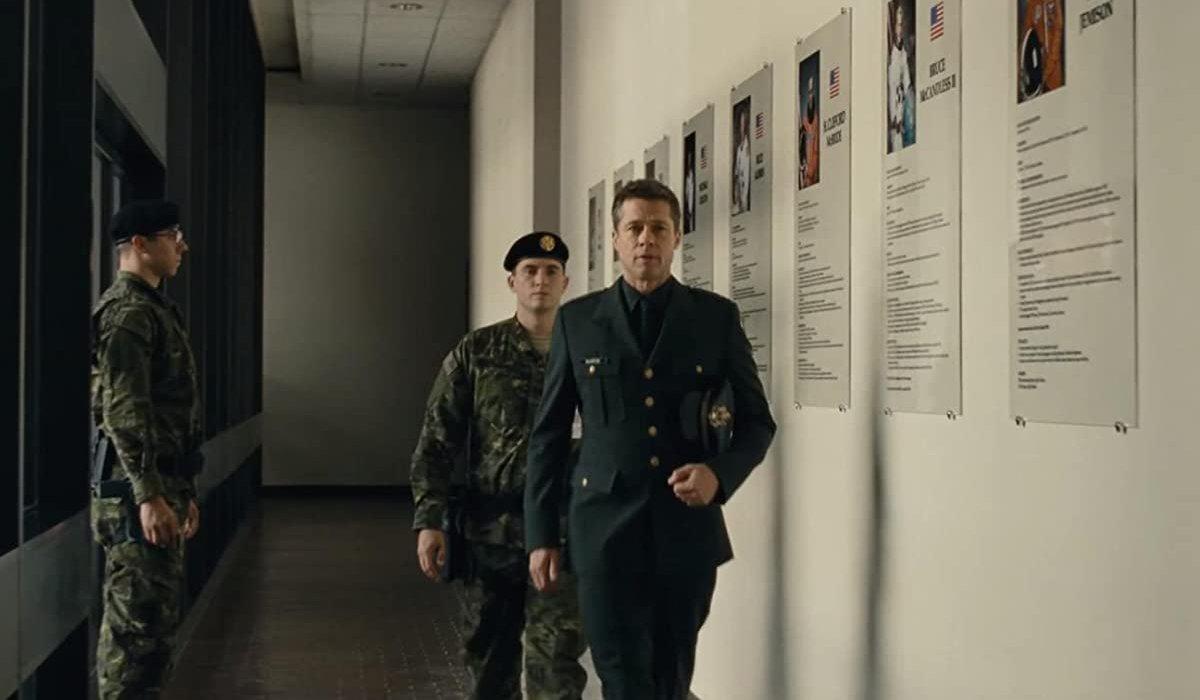 Ad Astra Brad Pitt walking down the hall in uniform