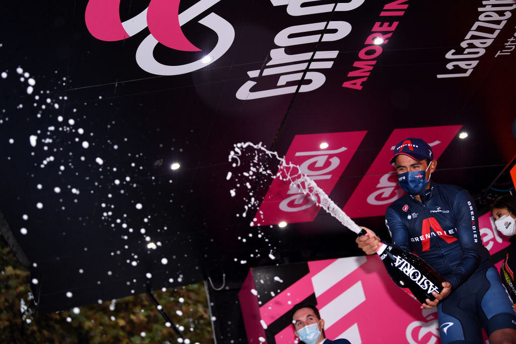 CESENATICO ITALY OCTOBER 15 Podium Jhonnatan Narvaez Prado of Ecuador and Team INEOS Grenadiers Celebration Champagne Mask Covid safety measures during the 103rd Giro dItalia 2020 Stage Twelve a 204km stage from Cesenatico to Cesenatico girodiitalia Giro on October 15 2020 in Cesenatico Italy Photo by Tim de WaeleGetty Images