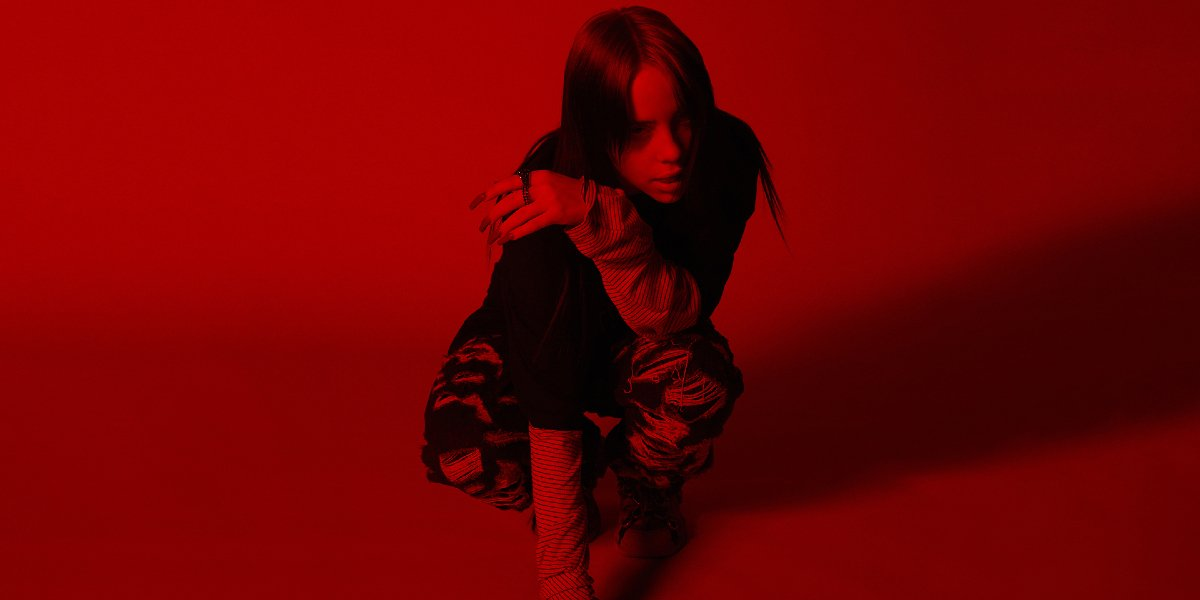 No Time To Die Billie Eilish crouching in a red atmosphere