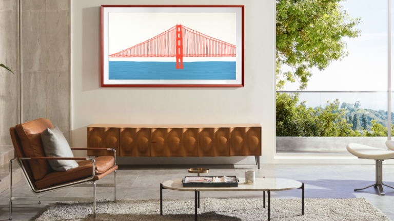 Samsung Frame TV with bevelled frame in Terracotta, wall-mounted in stylish living room