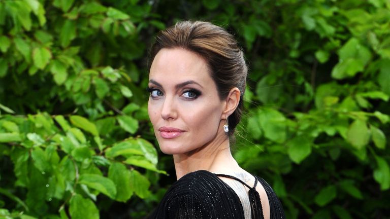 """Angelina Jolie attends a private reception as costumes and props from Disney's """"Maleficent"""" are exhibited in support of Great Ormond Street Hospital at Kensington Palace on May 8, 2014 in London, England"""
