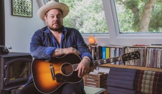 Nathaniel Rateliff with his new signature Gibson LG-2 Western acoustic guitar