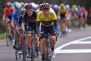 Rohan Dennis works for his Ineos Grenadiers teammates while leading the Tour de Romandie on stage 2