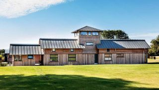 Timber frame house with metal roof