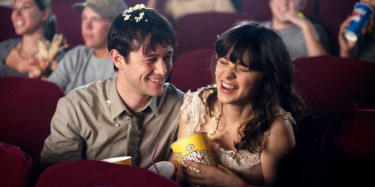 Joseph Gordon Levitt and Zooey Deschanel at a movie theater in 500 days of summer