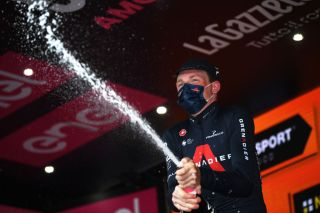 PIANCAVALLO ITALY OCTOBER 18 Podium Tao Geoghegan Hart of The United Kingdom and Team INEOS Grenadiers Celebration Champagne during the 103rd Giro dItalia 2020 Stage 15 a 185km stage from Base Aerea Rivolto Frecce Tricolori to Piancavallo 1290m girodiitalia Giro on October 18 2020 in Piancavallo Italy Photo by Tim de WaeleGetty Images
