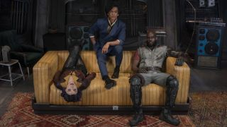 The main trio of Cowboy Bebop sat on a couch