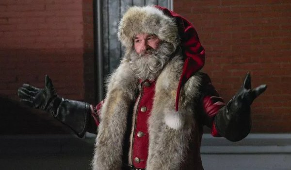 The Christmas Chronicles Kurt Russell stands confidently as Santa