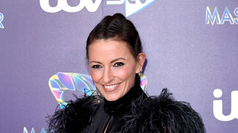 "Davina McCall attends ""The Masked Singer"" photocall at The Mayfair Hotel on December 12, 2019 in London, England"