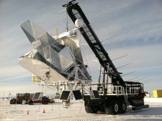 NASA's balloon-carried BLAST telescope is hoisted into launch position on Dec. 25, 2012, at McMurdo Station in Antarctica