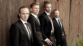 Pain Of Salvation in suits against a wall