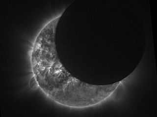 This view from space of a solar eclipse was captured on April 29, 2014 by the European Space Agency's Proba-2 satellite. The same satellite will observe the total solar eclipse of March 20, 2015.