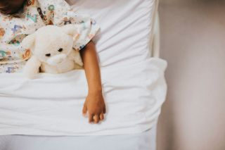 A child in a hospital bed.
